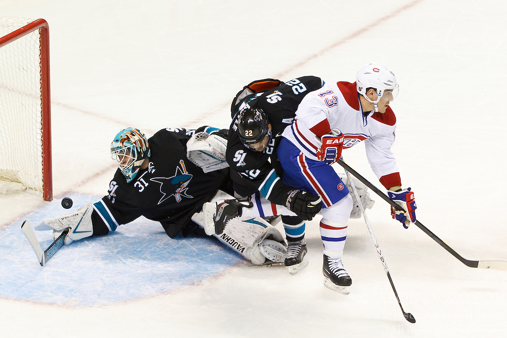 Dec 1, 2011; San Jose, CA, USA; Montreal Canadiens left wing Mike Cammalleri (13) scores on a deflection past San Jose Sharks goalie Antti Niemi (31) and defenseman Dan Boyle (center) during the first period at HP Pavilion.  Mandatory Credit: Jason O. Watson-US PRESSWIRE