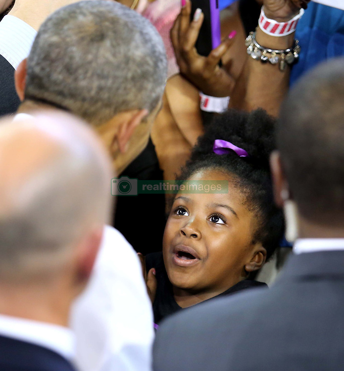 October 28, 2016 - Orlando, FL, USA - A young girl delights in meeting President Obama as he greets supporters during a rally for Democratic presidential nominee Hillary Clinton at the University of Central Florida on Friday, Oct. 28, 2016, in Orlando, Fla. (Credit Image: © Joe Burbank/TNS via ZUMA Wire)