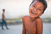 Laughing boy on Chindwin Riverbank, Monywa, Myanmar