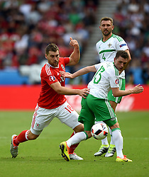 Sam Vokes of Wales battles for the ball with, Corry Evans of Northern Ireland  - Mandatory by-line: Joe Meredith/JMP - 25/06/2016 - FOOTBALL - Parc des Princes - Paris, France - Wales v Northern Ireland - UEFA European Championship Round of 16