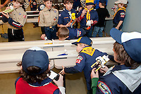 Kenaniah Valentine and Alec Beland go head to head while fellow scouts cheer them on during the 2nd annual Rain Gutter Regatta for Boy Scout Pack 243 Monday evening.  (Karen Bobotas/for the Laconia Daily Sun)