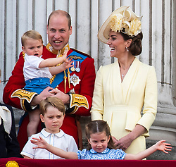 File photo dated 08/06/19 of the Duke and Duchess of Cambridge with their children, Prince Louis, Prince George and Princess Charlotte, on the balcony of Buckingham Place as they watch the flypast following Trooping the Colour ceremony. The military parade has marked the official birthday of the sovereign for more than 270 years.