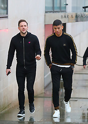 Manchester United's Marcos Rojo heads into Manchester city centre on Thursday afternoon to do some Christmas shopping with a friend