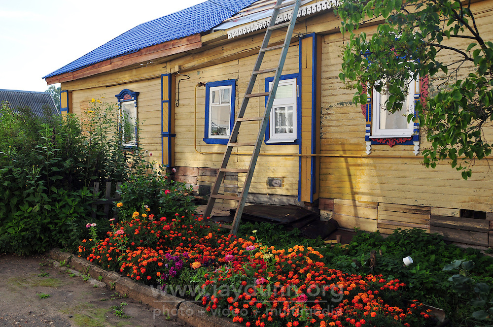 """Summer flowers alongside a house undergoing restoration in Uglich, Russia. As one of Russia's """"Golden Ring"""" cities, Uglich is designated a town of significant cultural importance."""