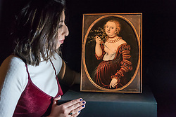 """© Licensed to London News Pictures. 01/12/2017. London, UK.  A staff member views """"Lucretia"""", 1525, by Lucas Cranach the Elder, (Est. GBP400-600k).  Preview of """"Masters of Light"""", Sotheby's Old Masters Evening Sale which will take place on 6 December at Sotheby's, New Bond Street. Photo credit: Stephen Chung/LNP"""