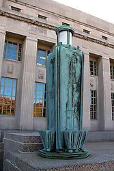 20 October 2010:  A heavy patina of corrosion adorns an old lamp in front of the United States Post Office in Market Street in St. Louis Missouri