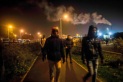 October 24, 2016 - Calais, France - Some migrants coming  from the Jungle to go to the warehouse to take the bus. Around 7 o clock in the morning, the first migrants arrived at the warehouse to be registered and dispached by buses, all around the French territory. Calais,  France, on 24 October 2016  (Credit Image: © Guillaume Pinon/NurPhoto via ZUMA Press)