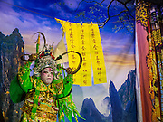 23 SEPTEMBER 2014 - BANGKOK, THAILAND: The performance of the Chinese opera on the first day of the Vegetarian Festival at the Chit Sia Ma Chinese shrine in Bangkok. The Vegetarian Festival is celebrated throughout Thailand. It is the Thai version of the The Nine Emperor Gods Festival, a nine-day Taoist celebration beginning on the eve of 9th lunar month of the Chinese calendar. During a period of nine days, those who are participating in the festival dress all in white and abstain from eating meat, poultry, seafood, and dairy products. Vendors and proprietors of restaurants indicate that vegetarian food is for sale by putting a yellow flag out with Thai characters for meatless written on it in red.    PHOTO BY JACK KURTZ