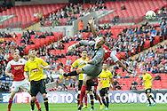 Fleetwood Town's  Antoni Sarcevic free kick (out of picture) goes  over Burton Albion's goalkeeper Dean Lyness to score his sides 1st goal take Fleetwood 1-0 . Skybet football league two play off final match , Burton Albion v Fleetwood Town at Wembley Stadium in  London on Monday 26th May 2014.<br /> pic by John Patrick Fletcher, Andrew Orchard sports photography.