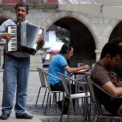 Guimaraes, Portugal - An accordian player plays for tips on the Plaza de Oliviera in Guimaraes...Photo by Susana Raab