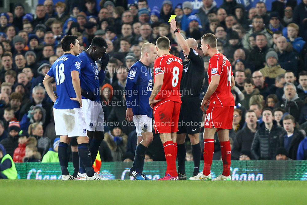 Steven Naismith of Everton receives a yellow card from referee Anthony Taylor. Barclays Premier league match, Everton v Liverpool at Goodison Park in Liverpool, Merseyside on Saturday 7th February 2015<br /> pic by Chris Stading, Andrew Orchard sports photography.
