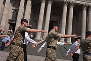 Members of the RAF Royal Air Force and British Army march under the columns of St Pauls Cathedral to attention, rehearsing the ceremonial event to mark the Queens 90th birthday the oldest for any British monarch at St Pauls Cathedral, on 9th June 2016, in London, United Kingdom. In summer sunshine they practice marching into position and ensuring theyre precisely in the correct spacing in preparation for the monarchs celebration here on 10th June, the day after.