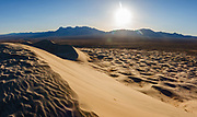 Providence Mountains (center) and Granite Peak (right), seen from Kelso Dunes Trail, in Mojave National Preserve, near the town of Baker, in San Bernardino County, California, USA. Multiple overlapping photos were stitched to make this panorama.