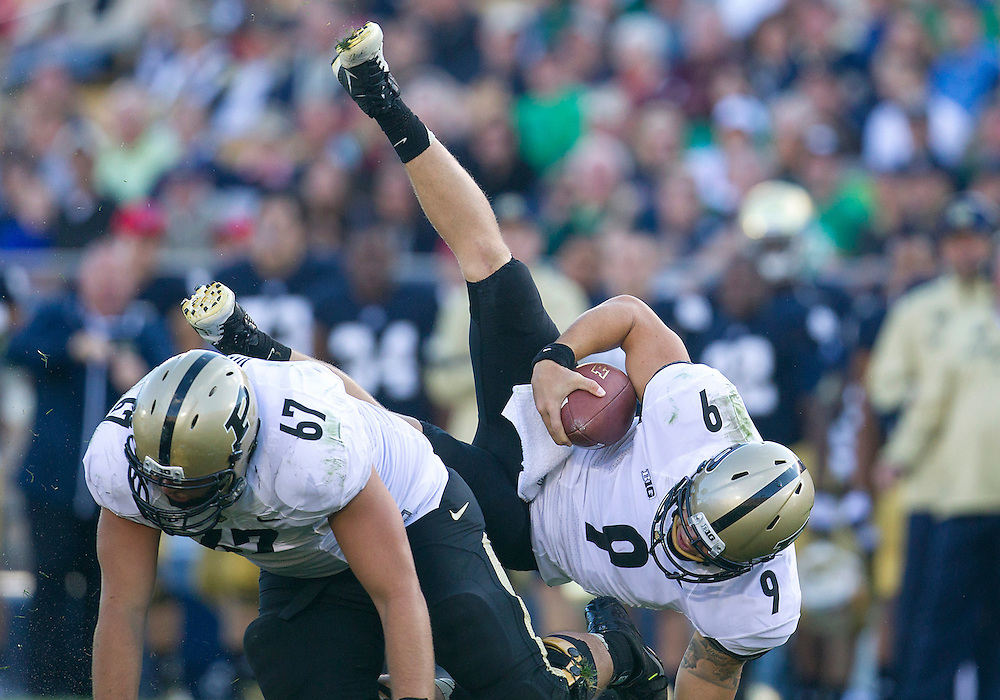 September 08, 2012:  Purdue quarterback Robert Marve (9) gets upended during NCAA Football game action between the Notre Dame Fighting Irish and the Purdue Boilermakers at Notre Dame Stadium in South Bend, Indiana.  Notre Dame defeated Purdue 20-17.