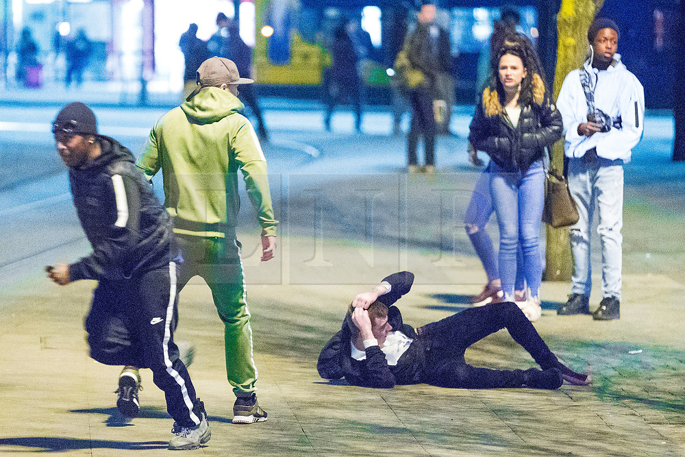 © Licensed to London News Pictures . 07/04/2017 . Manchester , UK . 11th in a sequence . Five youths on one as a fight breaks out in which a man's head is kicked and stamped upon , in Piccadilly Gardens . Greater Manchester Police have authorised dispersal powers and say they will ban people from the city centre for 48 hours , this evening (7th April 2017) , in order to tackle alcohol and spice abuse . Photo credit : Joel Goodman/LNP