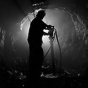 A miner after completing the drilling of a breast in a shrinkage stope, 700 foot level, Cheminis Mine, Larder Lake, Ontario. From the book Cage Call: Life and Death in the Hard Rock Mining Belt. An in-depth project spanning over 12-years examining communities in one of the richest mining regions in the world located in Northwestern Ontario and Northeastern Quebec in Canada.