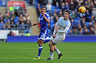 Cardiff City's Lee Peltier (l) heads the ball past Aston Villa's Jack Grealish. EFL Skybet championship match, Cardiff city v Aston Villa at the Cardiff City Stadium in Cardiff, South Wales on Monday 2nd January 2017.<br /> pic by Carl Robertson, Andrew Orchard sports photography.