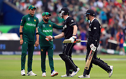 Pakistan's Mohammad Hafeez shakes hands with New Zealand's (left-right) Jimmy Neesham (97 not out) and Mitchell Santner (5 not out) as they walk off the pitch at the end of their innings during the ICC Cricket World Cup group stage match at Edgbaston, Birmingham.