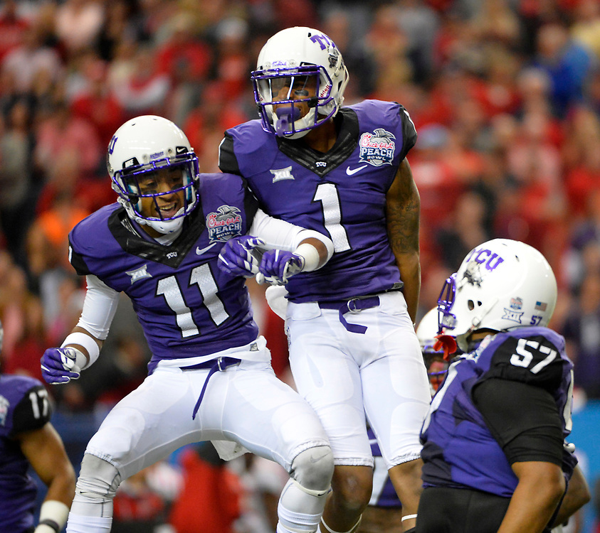 TCU Horned Frogs defenders Ranthony Texada (11), Chris Hackett (1), and Davion Pierson (57) celebrate in the Ole Miss vs. TCU Chick-fil-A Peach Bowl football game at the Georgia Dome on December 31, 2014. David Tulis / Abell Images for the Chick-fil-A Bowl