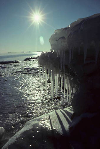 Lake Superior, ice formations cling to rocky shoreline of North Shore. Minnesota.