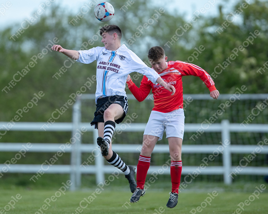 Manus Celtic's Daniel Kelly and Newmarket Celtic's Peter Power both jump to head the ball