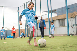 20 February 2020, Za'atari Camp, Jordan: A girl shoots the ball during football practice for girls in the Peace Oasis, a Lutheran World Federation space in the Za'atari Camp where Syrian refugees are offered a variety of activities on psychosocial support, including counselling, life skills trainings and other activities.