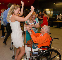 Anna Stivali and her great grandmother Jo Casey (orange) take to the dance floor with Diane Maher during Laconia High School's Senior / Senior dance at the Huot Center dining room Thursday evening.  (Karen Bobotas/for the Laconia Daily Sun)