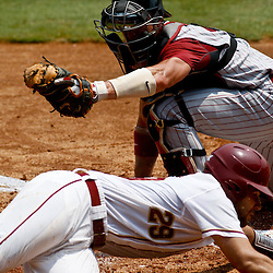 June 06, 2011; Tallahassee, FL, USA; Florida State Seminoles catcher Rafael Lopez (29) is tagged out by Alabama Crimson Tide catcher Brock Bennett (41) during the seventh inning of the Tallahassee regional of the 2011 NCAA baseball tournament as play resumed following the suspension of play due to severe weather last night at Dick Howser Stadium. Florida State defeated Alabama 11-1 to advance to a super regional. Mandatory Credit: Derick E. Hingle