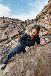 Sarah Hepola climbing boulder at Hueco Tanks State Park & Historic Site, El Paso, Texas. USA.