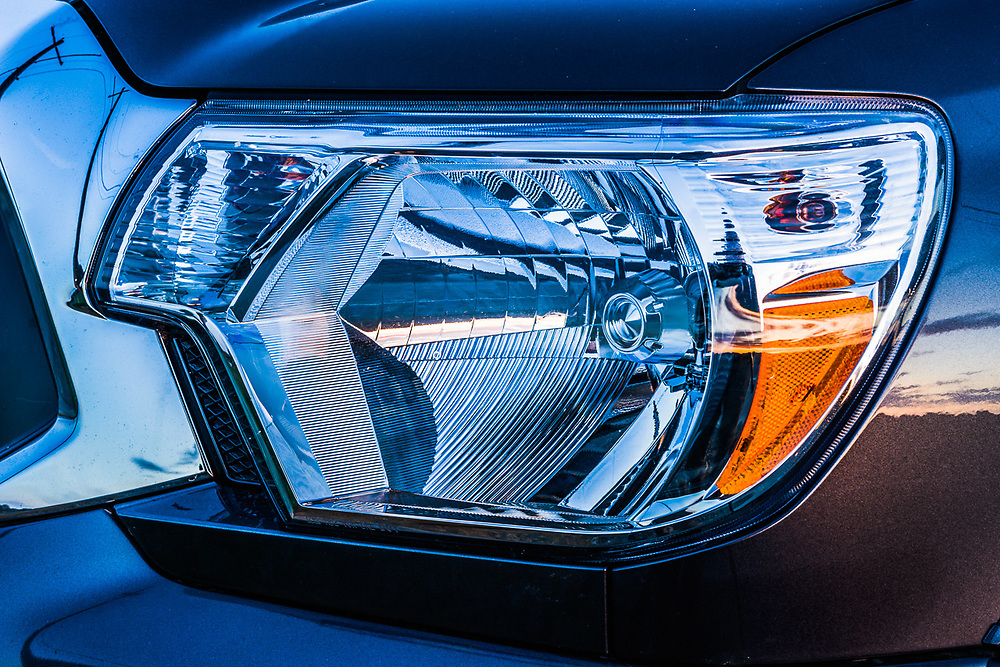Toyota Tacoma (2014) headlight detail, evening light, Port Angeles, Washington, USA