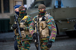 "© Licensed to London News Pictures. 23/11/2015. Brussels, Belgium. Belgian military patrolling the streets of central Brussels where the city is currently on ""lockdown"" amid ""imminent threat"" of Paris-style bomb and gun attacks. Photo credit: Ben Cawthra/LNP"