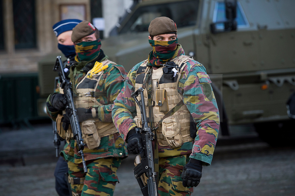 """© Licensed to London News Pictures. 23/11/2015. Brussels, Belgium. Belgian military patrolling the streets of central Brussels where the city is currently on """"lockdown"""" amid """"imminent threat"""" of Paris-style bomb and gun attacks. Photo credit: Ben Cawthra/LNP"""