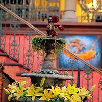 South America, Chile, Santiago. Como Agua para Chocolate restaurant fountain with flowers.