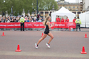 American elite female runner, Emily Sisson, on The Mall during the Virgin London Marathon on 28th April 2019 in London in the United Kingdom. Now in it's 39th year, the London Marathon is a large sporting event with over 40,000 runners expected to take part.