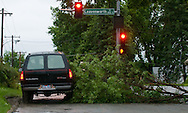 6/8/08 Omaha, NE Storm damage from a possible  tornado.  A truck drives around a downed limb at 55th and Leavenworth Streets..(chris machian/Omaha World Herald)