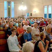 YARMOUTH, Maine -- July 26, 2019 -- Mildred Kenney and Lee Dionne from Cousins Island presented stories of life on Cousins Island before the bridge was built at the Cousins Island Chapel this evening. Bob Gifford followed with stories and photos from Littlejohn Island. Guests filled the chapel to standing room only. Photo by Roger S. Duncan  207-443-9665 http://www.rogerduncanphoto.com