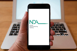 Using iPhone smartphone to display logo of Nuclear Decommissioning Authority in the UK