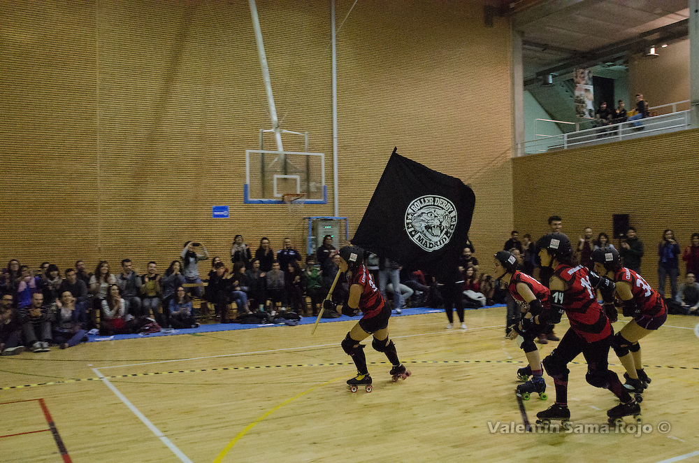 Roller Derby Madrid players carrying their flag celebrating their victory against Freaky Mons'ter Derby Ladies in Madrid.