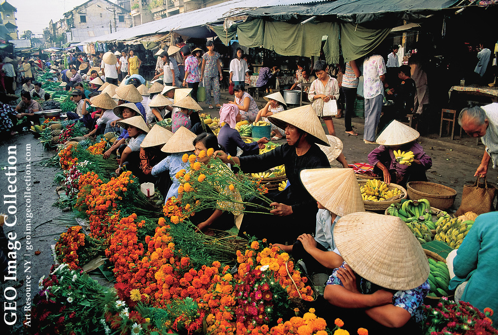 Flower growers and sellers do a brisk business for the Tet New Year in Cantho Market. Vietnam