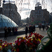 KIEV, UKRAINE - February 24, 2014: Thousands lay flowers and candles in memory of the anti-government protestors killed during violent clashes with Ukrainian special forces, in Kiev's Independence Square. CREDIT: Paulo Nunes dos Santos