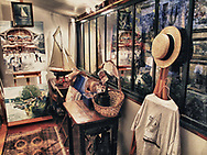 Paintings by Pierre Rannaud are reflected in the window of his display room off the garden: Chatou, France. Aspect Ratio 1w x 0.75h