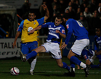Photo: Steve Bond/Sportsbeat Images.<br /> Macclesfield Town v Hereford United. Coca Cola League 2. 26/12/2007. Simon Johnson (L) abouit to be tackled by Sean Hessey (C)