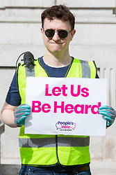 © Licensed to London News Pictures. 08/08/2019. London, UK. Peoples Vote activists dressed as waste collectors hold placards outside the Cabinet Office. They are protesting against a No Deal Brexit .  Photo credit: George Cracknell Wright/LNP
