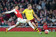 Scott Arfield of Burnley is intercepted by Gabriel Paulista of Arsenal. The Emirates FA cup, 4th round match, Arsenal v Burnley at the Emirates Stadium in London on Saturday 30th January 2016.<br /> pic by John Patrick Fletcher, Andrew Orchard sports photography.