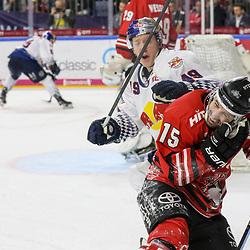 Muenchens Mark Voakes (Nr.49) bekommt eine 2min Strafe wegen den Treffers mit dem Schläger am Kopf von Koelns Taylor Aronson (Nr.15)  beim Spiel in der DEL, Koelner Haie (rot) - EHC Red Bull Muenchen (weiss).<br /> <br /> Foto © PIX-Sportfotos *** Foto ist honorarpflichtig! *** Auf Anfrage in hoeherer Qualitaet/Aufloesung. Belegexemplar erbeten. Veroeffentlichung ausschliesslich fuer journalistisch-publizistische Zwecke. For editorial use only.