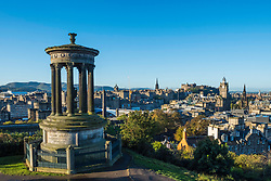 Skyline of Edinburgh from Calton Hill in early morning sunshine, Scotland, United Kingdom.