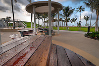 Picnic tables very early in the morning, at South Pointe Park, Miami Beach, Florida.