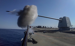 RED SEA (Aug. 1, 2018) The guided-missile destroyer USS Jason Dunham (DDG 109) fires its 5-inch gun during a gunnery exercise as part of Eagle Salute 18. Eagle Salute 18 is a surface exercise with the Egyptian Naval Force conducted to enhance interoperability and war-fighting readiness, fortify military-to-military relationships and advance operational capabilities of all participating units. Jason Dunham is deployed to the U.S. 5th Fleet area of operations in support of naval operations to ensure maritime stability and security in the Central region, connecting the Mediterranean and the Pacific through the western Indian Ocean and three strategic choke points. (U.S. Navy photo by Mass Communication Specialist 3rd Class Jonathan Clay/Released) 180801-N-UX013-1045