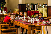 Young Ethiopian boys eating breakfast in the restaurant of the Haile Resort Arba Minch, Ethiopia.