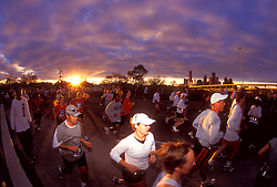 Stock photo of a group of marathon runners at the early morning start